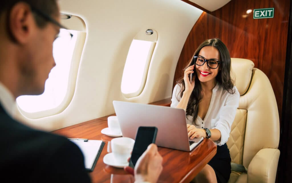 Business personnel aboard private jet